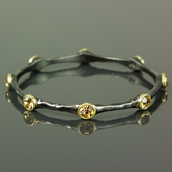 Our newest Trina bracelet in gunmetal and Topaz stones! $38
