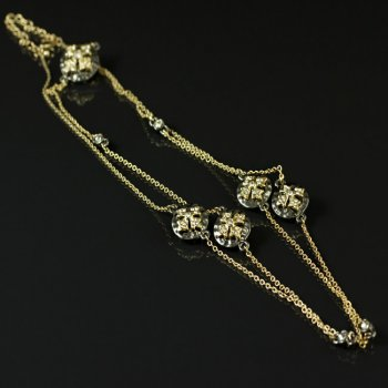 Our Simone Deux II necklace in gunmetal and gold and sparkling crystals from Austria! $42