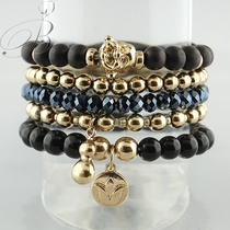 Ohm beaded bracelet in semi-precious stones and crystals $34